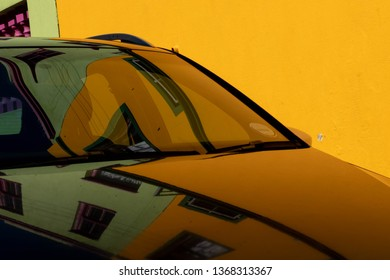 Car with reflection of houses in the Malay Quarter, Bo-Kaap, Cape Town, South Africa. Historical area of brightly painted houses in the city centre, housing largely Muslim families.