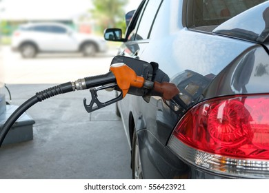 Car refueling in filling station.