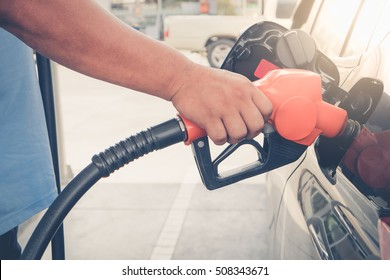 Car refueling fuel on petrol station. Man pumping gasoline oil. Service is filling gas or biodiesel into the tank. Automotive industry or transportation concept