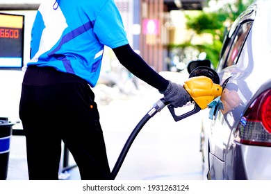 The car is refueling at the gas station.