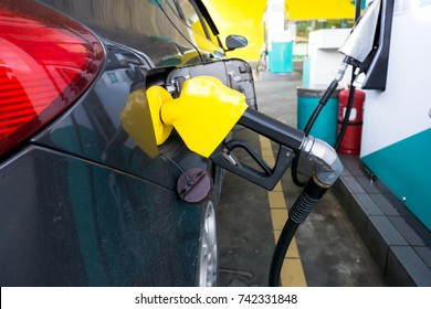 Car refueling at the a gas station in Kota Kinabalu, Sabah Borneo, Malaysia.