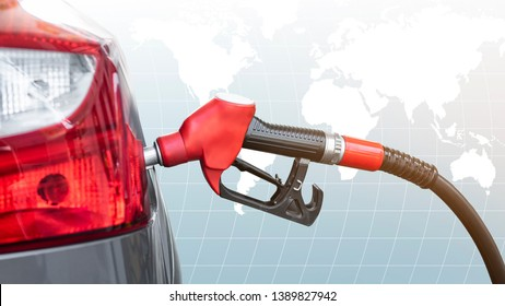 Car refueling  at gas station.With Red Fuel Nozzle ,Global map backgrounds