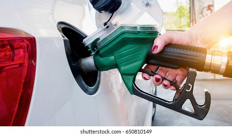 Car refueling on gas station. Woman pumping gasoline oil.