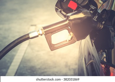 Car refueling on petrol station. Fuel pump with gasoline. This photo can be used for fuel industry or transportation concept