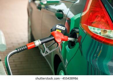 Car refueling on a petrol station closeup