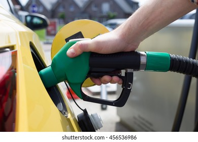 Car refueling on petrol station. Man pumping gasoline fuel in car at gas station
