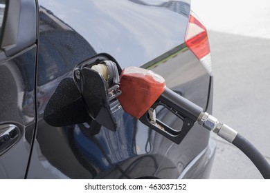 Car refueling on a petrol station, fuel nozzle, gas station
