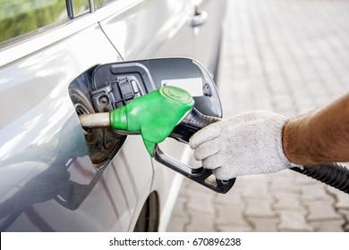 Car refueling on petrol station.