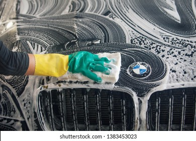car repair car advertising car wash, BMW advertising, Moscow, 1.11.2018: BMW motor company badge in front of the black car. BMW-German company for the production of cars, motorcycles and engines