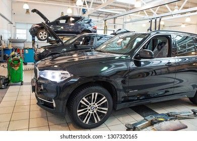 car repair, BMW advertising, Moscow, 1.11.2018: Bmw motor company badge on the front from a black car. BMW is a German automobile, motorcycle and engine manufacturing company founded in 1916