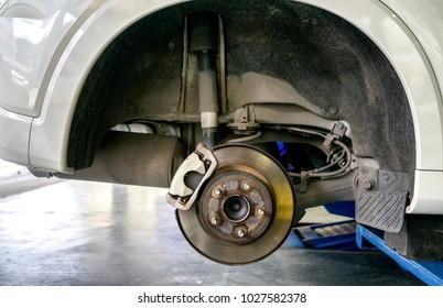 Car repair and maintenance. Check brake shoe and brake disk , caliper.