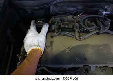 Car repair service, Auto mechanic checking oil level in a engine