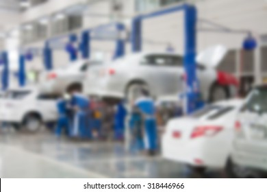 car repair service center blurred background