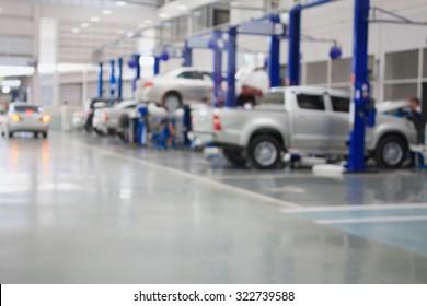 car repair service center blurred background