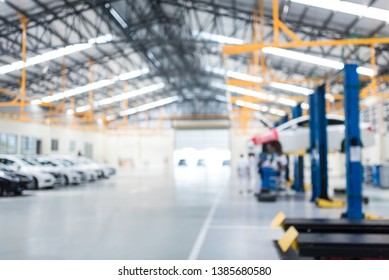 Car repair service center the epoxy floor in car factory service  , The interior of a big industrial building or factory with steel constructions.,Steel roof frame , blurred background for industry