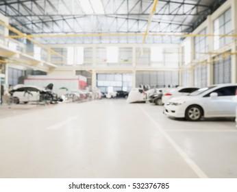 Car repair service centre interior blurred background