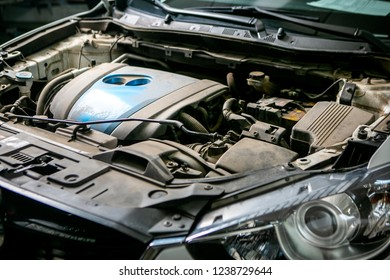 Car repair in car service. Dirty engine before washing, close-up