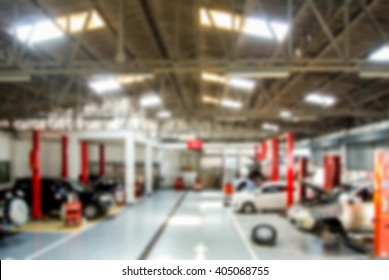car repair at service station. blurred photo  background
