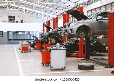 car repair station with soft-focus and over light in the background - Shutterstock ID 1166360425