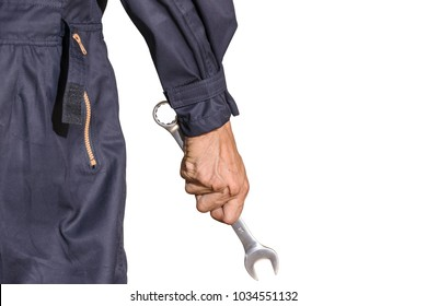 Car repairman wearing a dark blue uniform standing and holding a wrench that is an essential tool for a mechanic isolated on white background, Automotive industry and garage concepts.