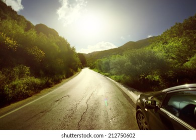 Car ride on road in sunny weather