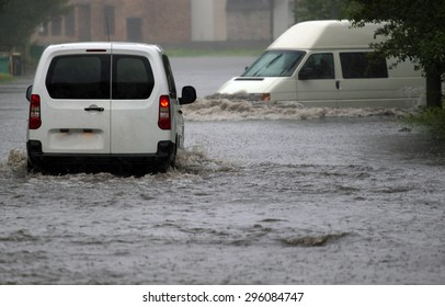 car rides in heavy rain on a flooded road