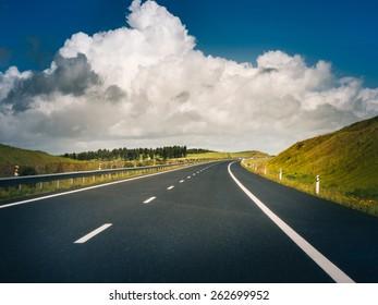 car road under beautiful solar sky