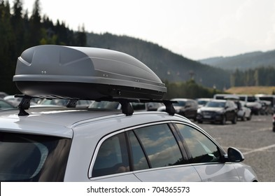 Car with the roof rack with cargo box