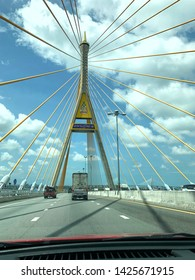 The car is running on a bridge with a blue sky background and white clouds in the clear sky atmosphere at Bhumibol 2 Bridge Bangkok Thailand, June 2019