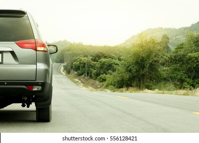 Car running on the road for travel trip have mountain and tree before to mountain. in Rayong Thailand.