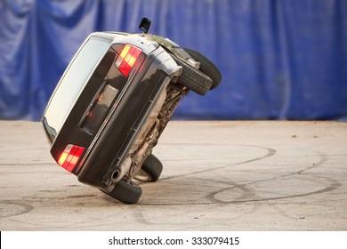 Car Running On Two Wheels Suggesting Danger Stunt Demo