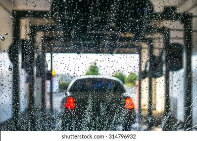 a car Running through automatic car wash.