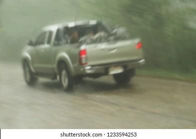 Car running through the rain, blurred.