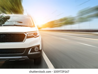 The car runs high on the road
