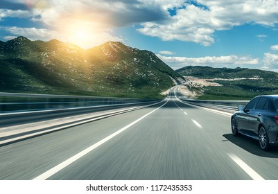 Car rushing along a high-speed highway.