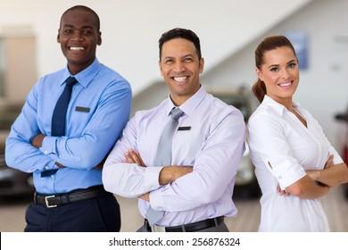 car sales staff standing inside showroom