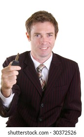 car salesman holding key ready for hand over