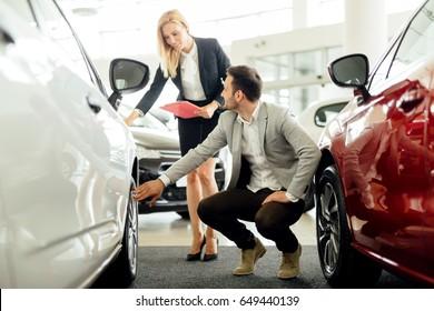 Car salesperson explaining tires options