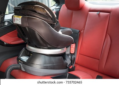 car seat placing in luxury sport car. baby safety concept