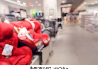 car seat for sale in business shopping mall, image blur background