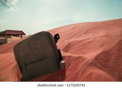 Car Seat submerged in the desert, in Al Madam abandoned town