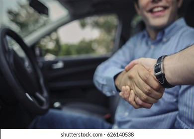 Car seller and Client Handshake