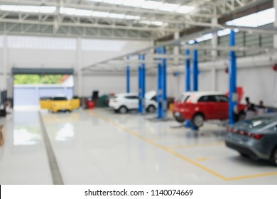 car service centre with auto at repair station bokeh light defocused blur background