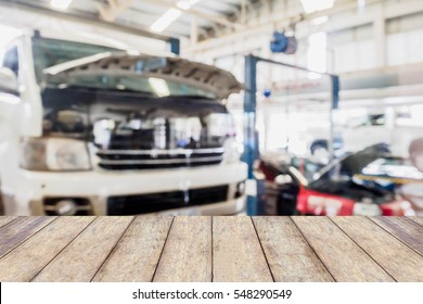 car service centre blurred background with wood table