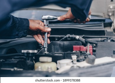car service, repair, maintenance. A technician checks collect detailed information during work. service maintenance of industrial to engine repair