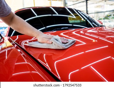 Car service worker polishing car with microfiber cloth. - Shutterstock ID 1792547533