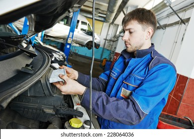 Car servicing, replacing air filter maintenance at auto repair shop