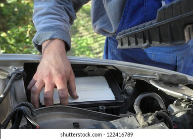 Car servicing, replacing of paper air filter