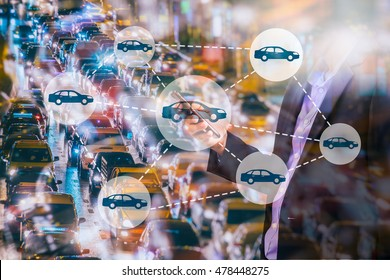 Car sharing concept. Sharing economy and collaborative consumption. Car sharing icons on Double exposure of  Business man using smart phone and city traffic at night. Worm tone