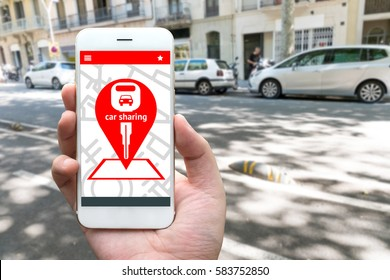 Car sharing service or rental concept. Sharing economy and collaborative consumption. Customer hand holding smart phone with icons application screen and blur car background.